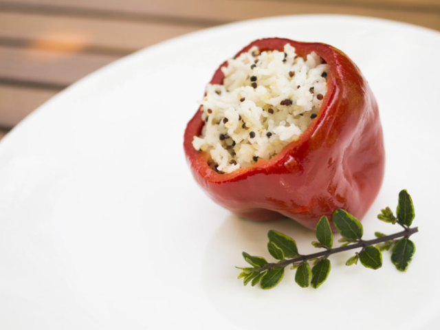 Red bell pepper stuffed with rice on a plate