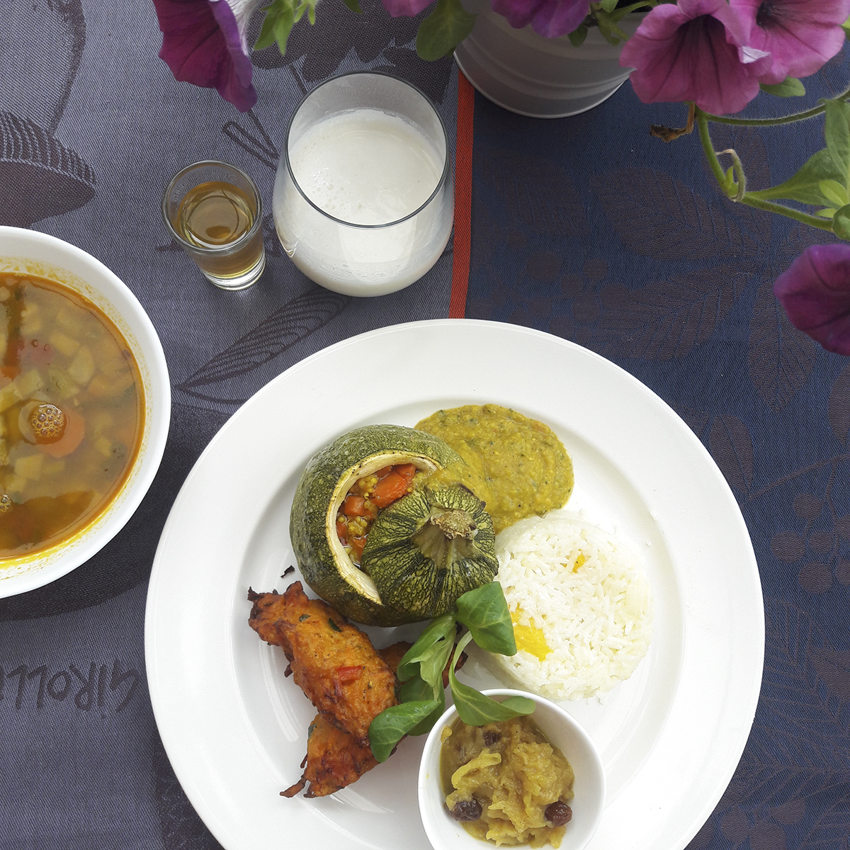 Vegetable fritters, apple chutney, stuffed pumpkin, vegetable stew and lassi